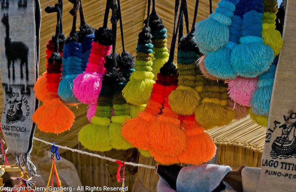 Local crafts for sale on the Uros Islands in Lake Titicaca, Peru.