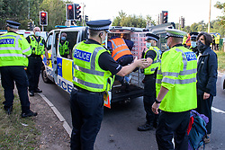 © Licensed to London News Pictures. 20/09/2021. Rickmansworth, UK. Protesters from climate campaign 'Insulate Britain', an offshoot of Extinction Rebellion (XR), block the anti-clockwise slip road at junction 18 on the M25 London Orbital Motorway. Photo credit: Peter Manning/LNP