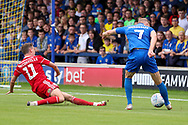AFC Wimbledon midfielder Scott Wagstaff (7) crossing into the box during the EFL Sky Bet League 1 match between AFC Wimbledon and Accrington Stanley at the Cherry Red Records Stadium, Kingston, England on 17 August 2019.