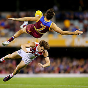 BRISBANE, AUSTRALIA - JULY 12:  Jed Adcock of the Lions and Nick Smith of the Swans collide during the round 15 AFL match between the Brisbane Lions and the Sydney Swans at The Gabba on July 12, 2015 in Brisbane, Australia.  (Photo by Chris Hyde/Getty Images) *** Local Caption *** Jed Adcock, Nick Smith