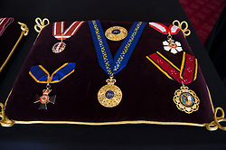 The Order of Australian Knight, the Order of New Zealand, the order of Canada, the Canada Order of Military Merit, and the Papua New Guinea Order of Logohu, sewn onto a cushion in St James's Palace, London. The cushions displaying medals and decorations conferred on the Duke of Edinburgh by the United Kingdom and other countries across the world, together with his Field Marshal's baton and Royal Air Force Wings, and insignia from Denmark and Greece, will be placed on the altar in St George's Chapel, in Windsor, ahead of his funeral on Saturday. Picture date: Tuesday April 13, 2021.