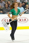 DALLAS, TX - OCTOBER 17:  A Dallas Stars Ice Girl clears the ice during a break between the San Jose Sharks and the Dallas Stars on October 17, 2013 at the American Airlines Center in Dallas, Texas.  (Photo by Cooper Neill/Getty Images) *** Local Caption ***