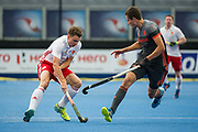 England's Harry Martin is watched by Jonas de Geus of the Netherlands. England v The Netherlands - Semi Final - Hockey World League Semi Final, Lee Valley Hockey and Tennis Centre, London, United Kingdom on 24 June 2017. Photo: Simon Parker