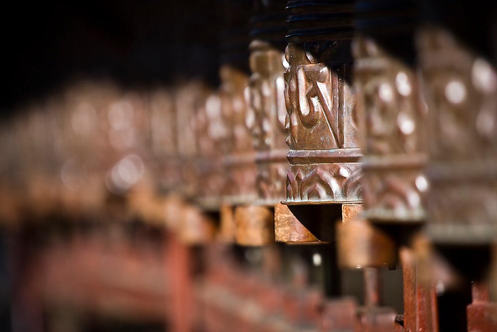 Copper prayer wheels at Tengboche Monastery, Khumbu (Everest) region, Sagarmatha National Park, Himalaya Mountains, Nepal.