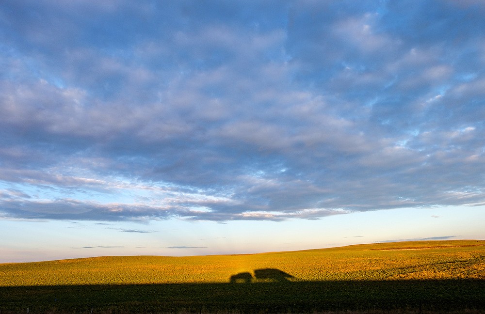 Shadow play with our Ex[edition and Airstream against the rolling plains of North Dakota.