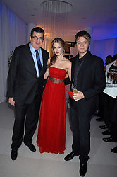 Left to right, JEAN-MARC LACAVE Chief Executive of Tag Heuer, DELTA GOODREM and BRIAN McFADDEN attending the Tag Heuer party where an exhibition of photographs by Mary McCartney celebrating 15 exception women from 15 countries was unveiled at the Royal College of Arts, Kensington Gore, London on 8th February 2007.<br /><br />NON EXCLUSIVE - WORLD RIGHTS