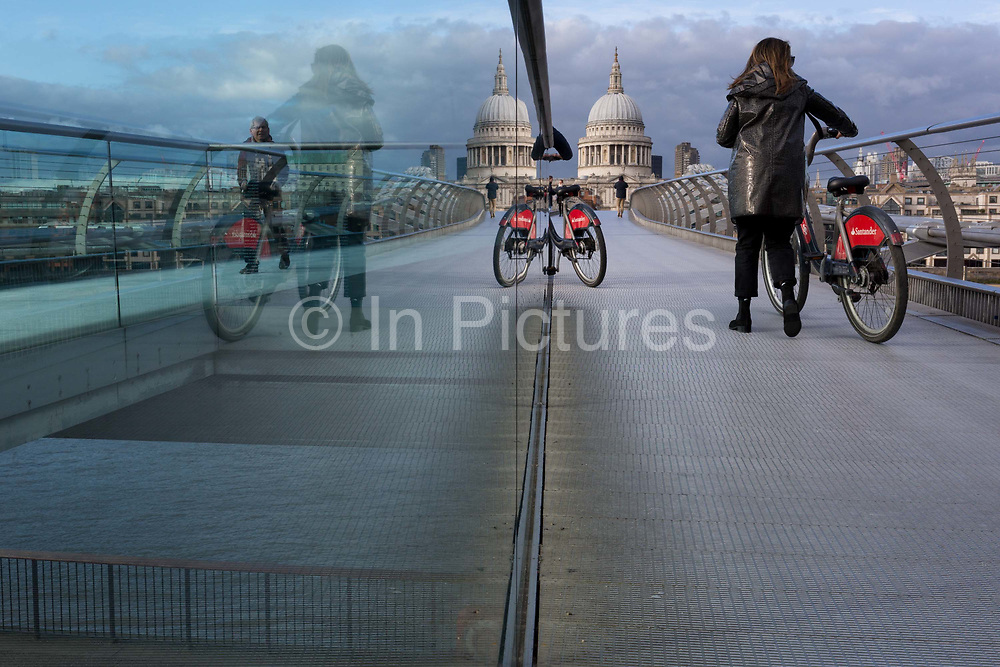 As the UK government announces further Coronavirus-related restrictions to its citizens, with the immediate closure of pubs, cafes, gyms and cinemas, and the worldwide number of deaths reaching 10,000 with 240,000 cases, 953 of those in London alone, the Millennium Bridge remains quiet and largely un-used, <br /> on 20th March 2020, in London, England.