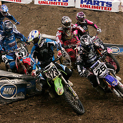 14 March 2009: James Povolny (323) fights for position on a turn with Nathan Ramsey (25) during a qualifying heat of a Monster Energy AMA Supercross race at the Louisiana Superdome in New Orleans, Louisiana
