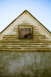 detail of a pitched roof home in New Mexico
