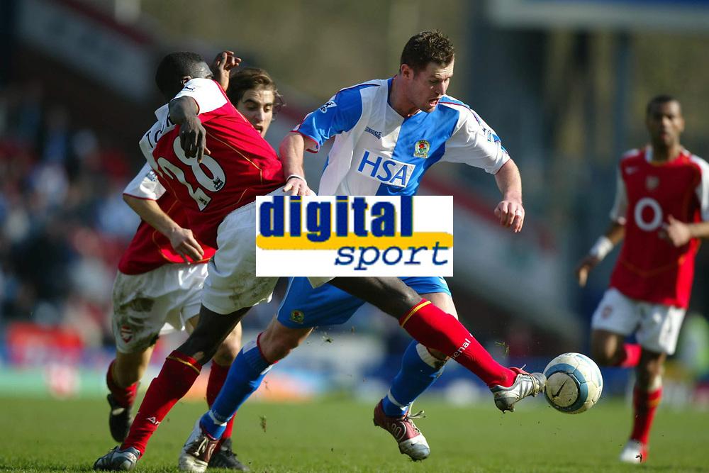 Fotball<br /> Premier League 2004/05<br /> Blackburn v Arsenal<br /> 19. mars 2005<br /> Foto: Digitalsport<br /> NORWAY ONLY<br /> Brett Emerton of Blackburn Rovers is tackled by Kolo Toure of Arsenal