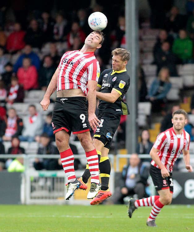 Lincoln City's Matt Rhead wins an aerial battle with Crawley Town's Dannie Bulman<br /> <br /> Photographer David Shipman/CameraSport<br /> <br /> The EFL Sky Bet League Two - Lincoln City v Crawley Town - Saturday September 8th 2018 - Sincil Bank - Lincoln<br /> <br /> World Copyright © 2018 CameraSport. All rights reserved. 43 Linden Ave. Countesthorpe. Leicester. England. LE8 5PG - Tel: +44 (0) 116 277 4147 - admin@camerasport.com - www.camerasport.com