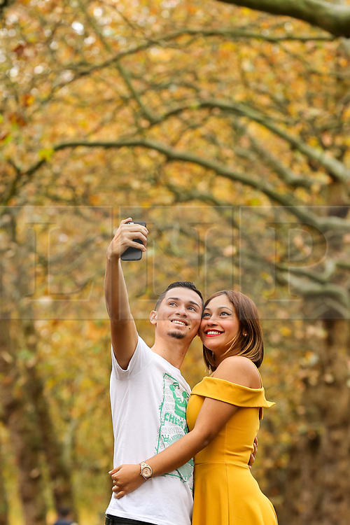 © Licensed to London News Pictures. 01/11/2019. London, UK. Jerry (L) and Yorklenny (R) from Panama are seen taking a selfie on a mild autumnal morning in St James's Park, Westminster. Photo credit: Dinendra Haria/LNP
