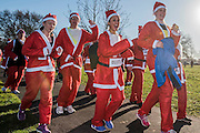 Thosuands of runners, of all ages, in santa suits and other Christmas costumes runaround Clapham Common for Great Ormond Street Hospital and for fun. London 30 Nov 2016