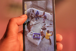 March 22, 2019 - Gurugram, Assam, India - A man watches the video on his mobile phone in which a group of around 20 men attacked a Muslim Family in Bhoop Singh Nagar of Bhondsi, Gurugram Haryana on 21 March 2019  (Credit Image: © Nasir Kachroo/NurPhoto via ZUMA Press)