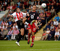 Fotball<br /> England 2005/2006<br /> Foto: SBI/Digitalsport<br /> NORWAY ONLY<br /> <br /> Cheltenham v Leyton Orient<br /> Coca Cola League 2.<br /> 27/08/2005.<br /> JJ Melligan and Daryl McMahon challenge for the ball