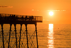 ©Licensed to London News Pictures. 06/06/2019.<br /> Aberystwyth, UK. A glorious sunset at the pier on a warm and clear summer evening in Aberystwyth on the west wales coast, at the end of a day of intense rain showers and bright sunshine. Photo credit: Keith Morris/LNP