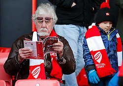 A Bristol City fan reads the match programme before the match - Photo mandatory by-line: Rogan Thomson/JMP - 07966 386802 - 25/01/2015 - SPORT - FOOTBALL - Bristol, England - Ashton Gate Stadium - Bristol City v West Ham United - FA Cup Fourth Round Proper.