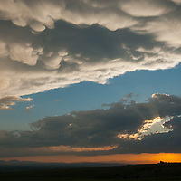 Clouds lit by a sunset hover over mountains surrounding Montana's Gallatin Valley.