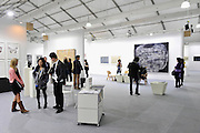 HONG KONG - MARCH 13:  Visitors in the halls of art fair Art Central on its preview day on March 13, 2015 in Hong Kong, Hong Kong.  (Photo by Lucas Schifres/Getty Images)