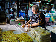 29 JANUARY 2019 - BANGKOK, THAILAND:       A man working in his family workshop packages crab sausages that will be sold during Chinese New Year. Chinese New Year celebrations in Bangkok start on February 4, 2019. The coming year will be the Year of the Pig in the Chinese zodiac. About 14% of Thais are of Chinese ancestry and Lunar New Year, also called Chinese New Year or Tet is widely celebrated in Chinese communities in Thailand.      PHOTO BY JACK KURTZ
