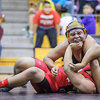 021514       Cable Hoover<br /> <br /> Gallup Bengal Chad Yazzie presses Grants Pirate Don Ramirez to the mat during the District 6-4A wrestling meet at Gallup High School Saturday.