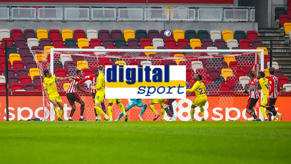 Football - 2020 / 2021 Sky Bet (EFL) Championship - Brentford vs. Wycombe Wanderers  - Brentford Community Stadium<br /> <br /> Admiral Muskwe (Wycombe Wanderers) waits at the far post to score his teams second goal as the ball is headed back across <br /> <br /> COLORSPORT/DANIEL BEARHAM