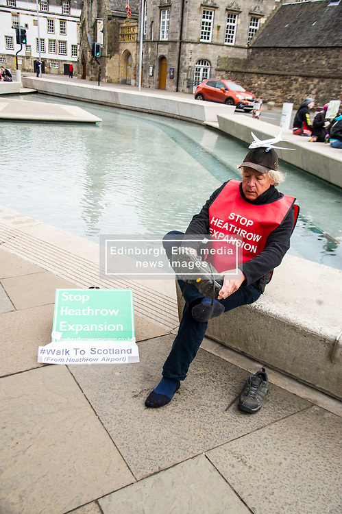 Pictured: Neil Keveren<br /> <br /> Anti-Heathrow third runway campaigner Neil Keveren, 50, arrives outside the Scottish Parliament after walking nearly 400 miles in protest at SNP backing for a third runway at the London airport. Neil walked on average 20 miles a day since 4 April with his support van givimg him a target to aim for each day.  Some of the residents on the flight path for the new runway have been there for over 40 years and many for all of their lives.  Flights arrive every three minutes between 4 and 5 am with the frequency increasing to every 90 seconds after 5am.<br /> Ger Harley   EEm 27 April 2017