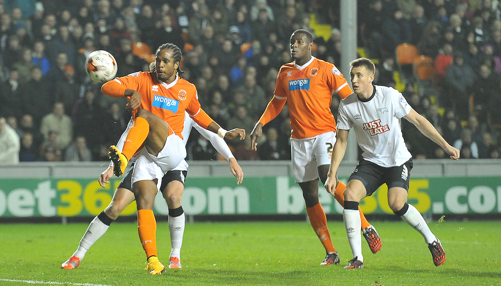 Blackpool's Nathan Delfouneso's shot goes over the bar<br /> <br /> Photographer Dave Howarth/CameraSport<br /> <br /> Football - The Football League Sky Bet Championship - Blackpool v Derby County - Tuesday 21st October 2014 - Bloomfield Road - Blackpool<br /> <br /> © CameraSport - 43 Linden Ave. Countesthorpe. Leicester. England. LE8 5PG - Tel: +44 (0) 116 277 4147 - admin@camerasport.com - www.camerasport.com
