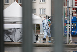 © Licensed to London News Pictures. 09/04/2018. London, UK. Forensic tent and screen as forensic officers work on the garage forecort at the scene in Collier Row, Romford where at 4:45hrs a man was shot by police and pronounced dead at the scene. Photo credit: Vickie Flores/LNP