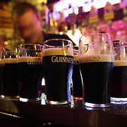 Prepared pints of Guinness on the bar at O'Donoghue's Bar, Dublin, Ireland..O'Donoghue's is known for it's traditional Irish music. It has been frequented of the years by many musicians from the Dubliner's to Bruce Springsteen. O'Donoghue's is recognized as one of Dublin's most famous pubs and is frequented by locals and tourist alike to play a tune or enjoy a pint of Guinness. Dublin, Ireland. Photo Tim Clayton