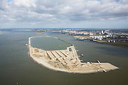 Nederland, Noord-Brabant, Moerdijk, 04-03-2008; Sassenplaat in het water van het Hollandsch Diep, aanleg van een baggerdepot in opdracht van Rijkswaterstaat;  het baggerspeciedepot moeten dienen voor de opslag van vervuild slib; in de achtergrond de Moerdijkbruggen; bagger, baggerbedrijven, baggeren, baggerspecie, afvalstoffen, Hollands Diep; Sassenplate in the water of the Hollands Diep, construction of a dredge depot in command of Rijkswaterstaat (department of Public Works); the dredged material depo is for the storage of polluted sludge; in the background the Moerdijk bridges, dredging, dredging companies, dredging, dredged material, waste;     .luchtfoto (toeslag); aerial photo (additional fee required); .foto Siebe Swart / photo Siebe Swart