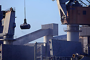 cranes at work loading unloading ship in a sea port