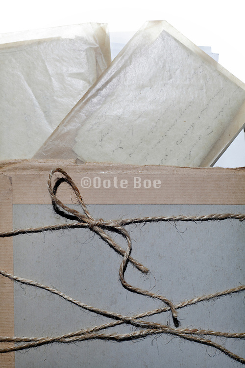 old letters in transparent envelopes bound together with carton protection wrapping