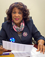 "Garden City, New York, USA. April 17, 2016. BERNICE SIMS, a campaign volunteer for Democratic presidential primary candidate Hillary Clinton, is working at the Canvass Kickoff at the Nassau County Democratic Office. Ms. Sims is a social worker, civil rights activist and author of the 2014 book ""Detour Before Midnight"" - her personal account of the last hours she and her family were with the Mississipi Burning civil rights workers killed by the KKK in 1964."