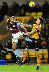 Gabriel Agbonlahor of Aston Villa challenges for the ball in the air with Danny Batth of Wolverhampton Wanderers - Mandatory by-line: Dougie Allward/JMP - 14/01/2017 - FOOTBALL - Molineux - Wolverhampton, England - Wolverhampton Wanderers v Aston Villa - Sky Bet Championship