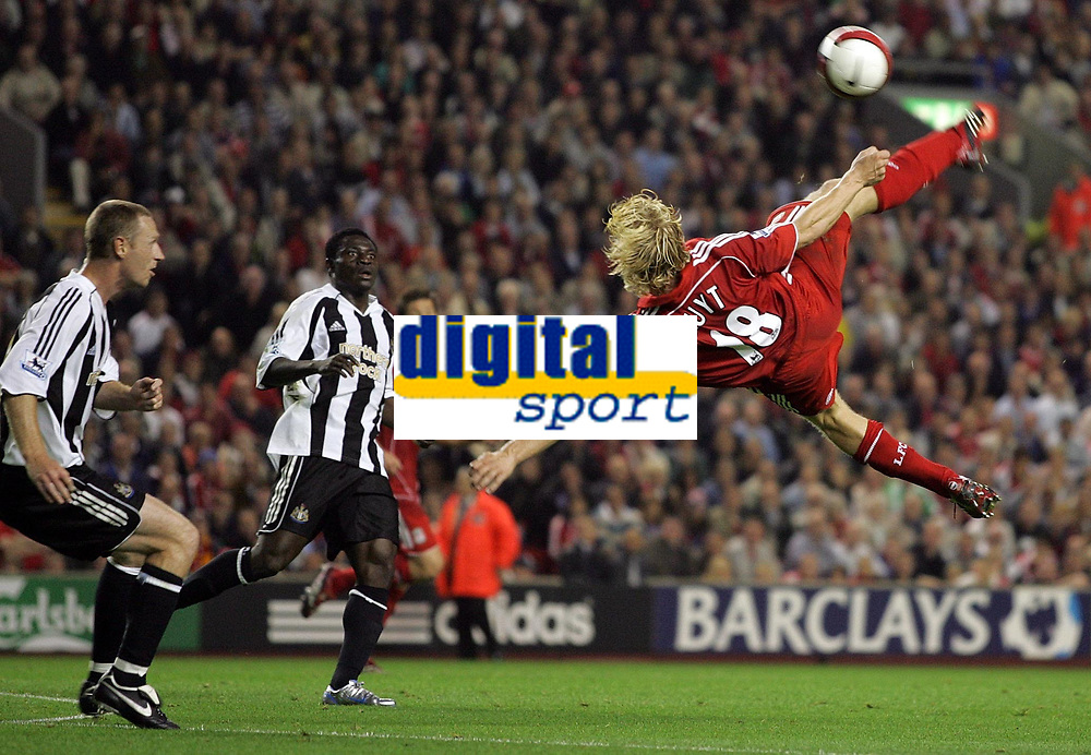 Photo: Paul Thomas.<br /> Liverpool v Newcastle United. The Barclays Premiership. 20/09/2006.<br /> <br /> Dirk Kuyt of Liverpool (18) shoots for goal under watch by Craig Moore (L) and Obafemi Martins.