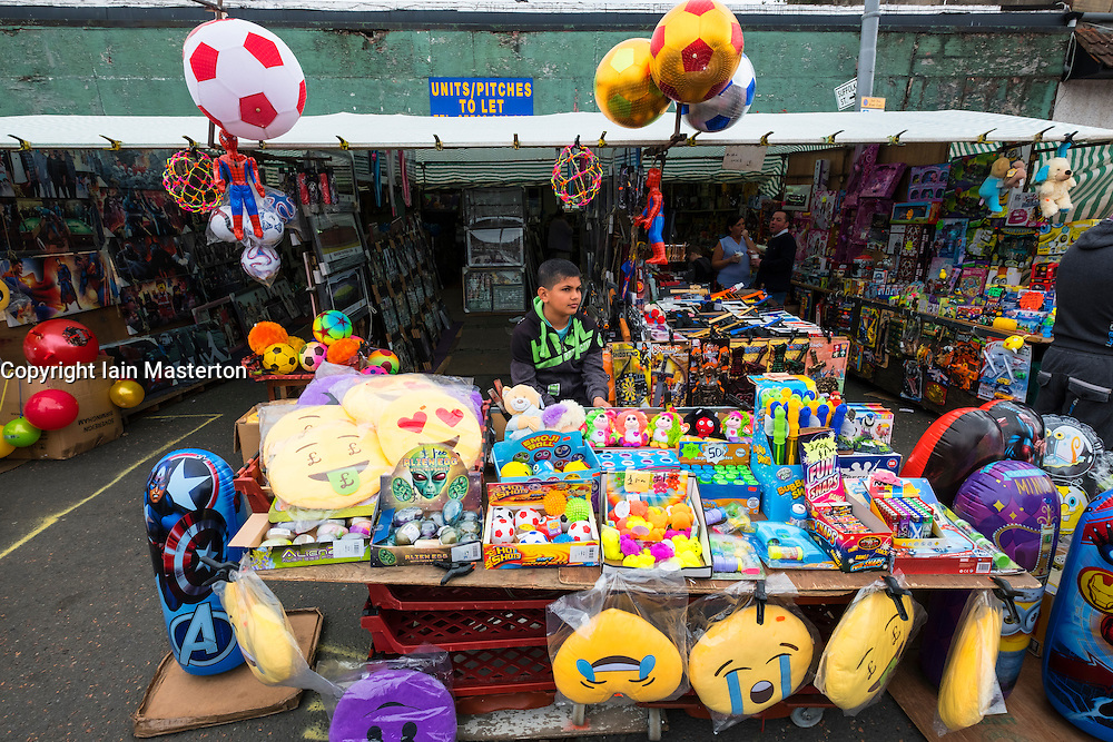 Stall selling cheap toys at Barras Market in Gallowgate Glasgow, United Kingdom