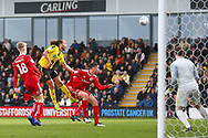 Burton Albion midfielder Marcus Harness (16) heads wide of the goal during the EFL Sky Bet League 1 match between Burton Albion and Accrington Stanley at the Pirelli Stadium, Burton upon Trent, England on 23 March 2019.
