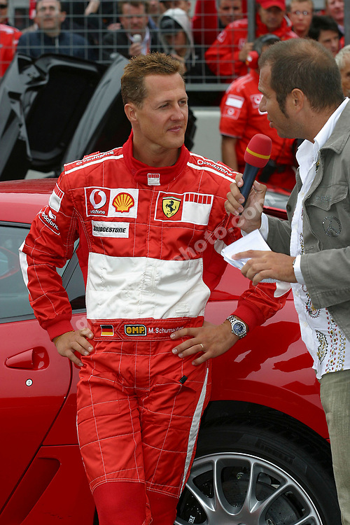 Michael Schumacher and TV commentator Kai Ebel at the 2006 Ferrari Days at the Nurburgring, September 2 - 3 2006. Photo: Grand Prix Photo