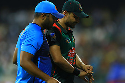 September 26, 2018 - Abu Dhabi, United Arab Emirates - Bangladesh cricket  captain Mashrafe Mortaza walks back to the pavilion with an injury during the Asia Cup 2018 cricket match  between Bangladesh and Pakistan at the Sheikh Zayed Stadium,Abu Dhabi, United Arab Emirates on September 26, 2018  (Credit Image: © Tharaka Basnayaka/NurPhoto/ZUMA Press)