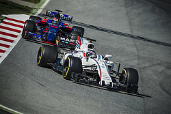 March 1, 2017 - Montmelo, Catalonia, Spain - LANCE STROLL (CAN) drives in his Williams Mercedes FW40 on track followed by DANIIL KVYAT (RUS) of team Toro Rosso during day 3 of Formula One testing at Circuit de Catalunya (Credit Image: © Matthias Oesterle via ZUMA Wire)