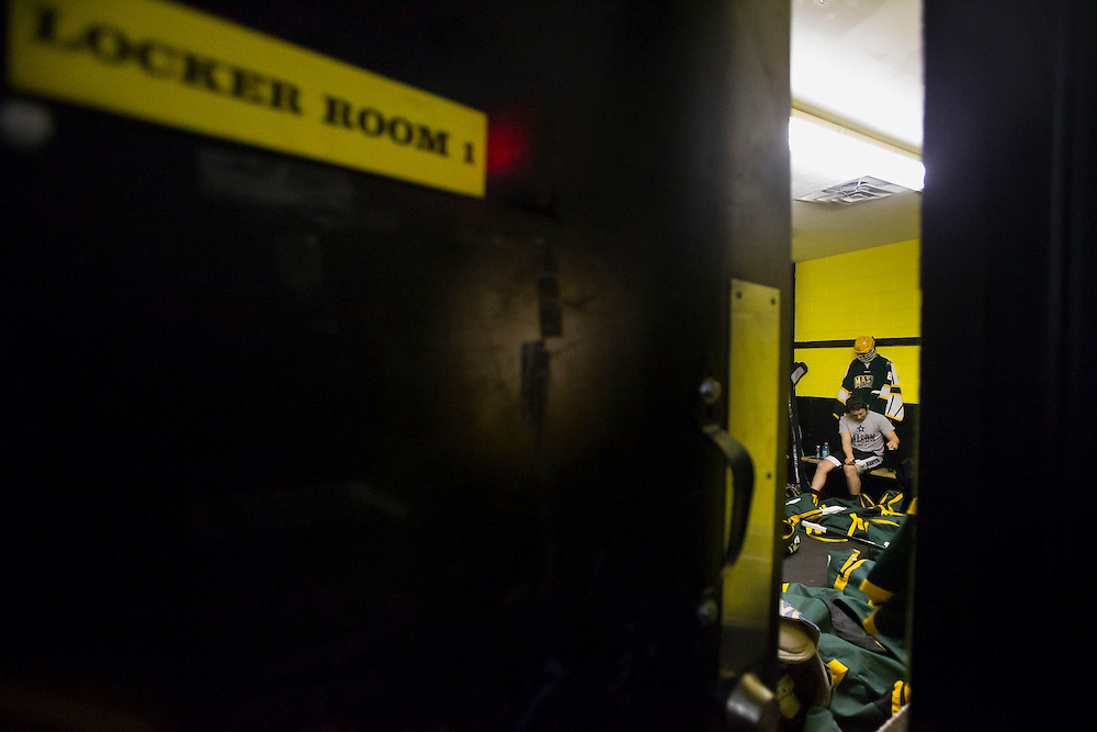 George Mason forward, Daniel Gassel, listens to music while getting suited up in the team locker room before facing off against  #8 ranked Christopher Newport University in Newport News, VA on January 25, 2014.