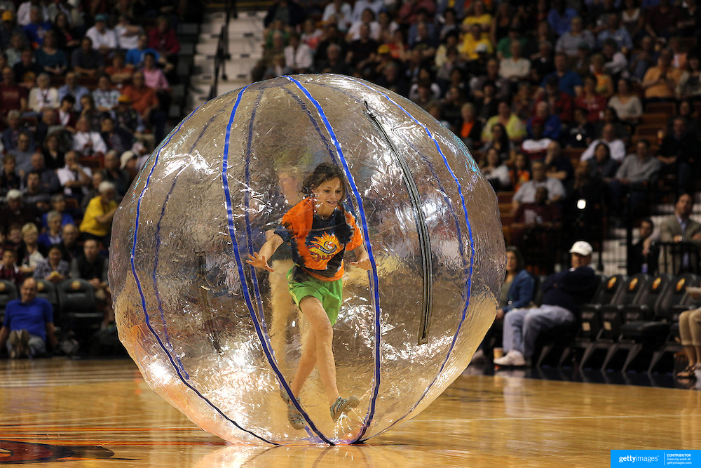 Youngsters in competition during time out entertainment during the Connecticut Sun Vs Seattle Storm WNBA regular season game at Mohegan Sun Arena, Uncasville, Connecticut, USA. 23rd May 2014. Photo Tim Clayton