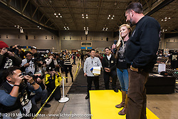 Jamie and Kutty Noteboom get introduced to the crowd at the Annual Mooneyes Yokohama Hot Rod and Custom Show. Japan. Sunday, December 7, 2014. Photograph ©2014 Michael Lichter.