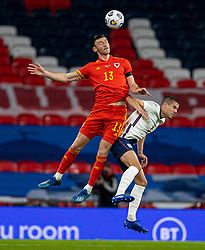 LONDON, ENGLAND - Thursday, October 8, 2020: Wales' Kieffer Moore (L) challenges for a header with England's Conor Coady during the International Friendly match between England and Wales at Wembley Stadium. The game was played behind closed doors due to the UK Government's social distancing laws prohibiting supporters from attending events inside stadiums as a result of the Coronavirus Pandemic. England won 3-0. (Pic by David Rawcliffe/Propaganda)