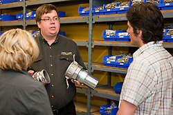 Chris May of Yukon Pump shows supplies to customers