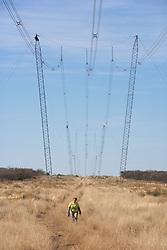 Estela Walking Under Power Lines