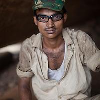 A worker in a boatyard on the Buriganga river, Dhaka, Bangladesh