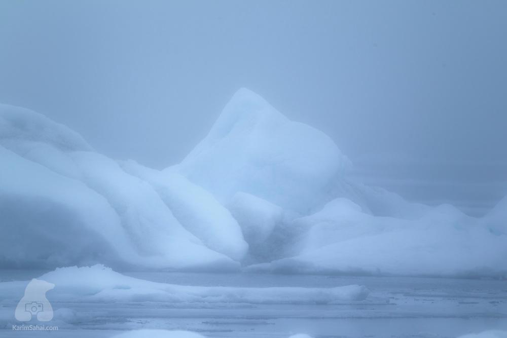 Iceberg in the fog in the north of Spitsbergen island, Svalbard