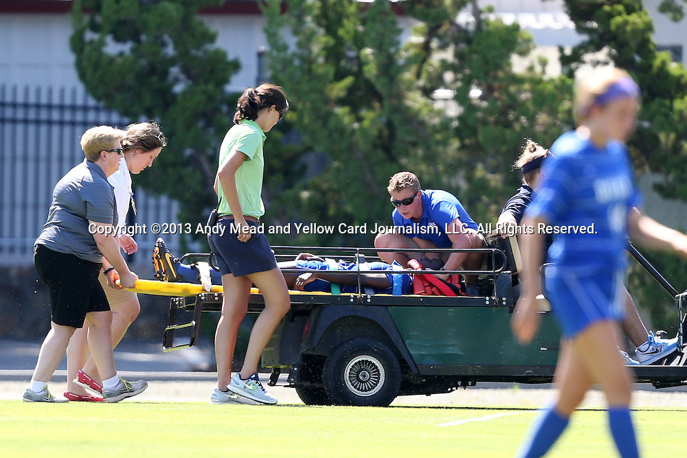 30 August 2013: Duke's Tabria Williford is carted off the field with medical personal stabilizing her head and kneck after suffering a first half injury. The Duke University Blue Devils played the Kennesaw State University Owls at Fetzer Field in Chapel Hill, NC in a 2013 NCAA Division I Women's Soccer match. Duke won 1-0.